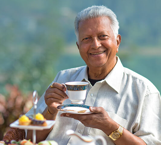 Owner of Dilmah Holding a Tea Cup