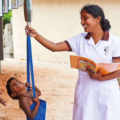 Measuring the Weight of a Child by a Nurse