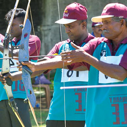 People Holding Bows and Doing Archery