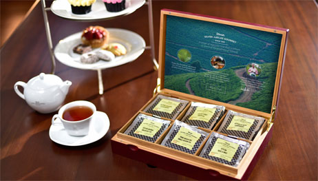 Dilmah Tea Sachets next to a Cup of Tea