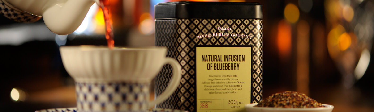 Container of Natural Infusion of Blueberry and a Cup of Tea