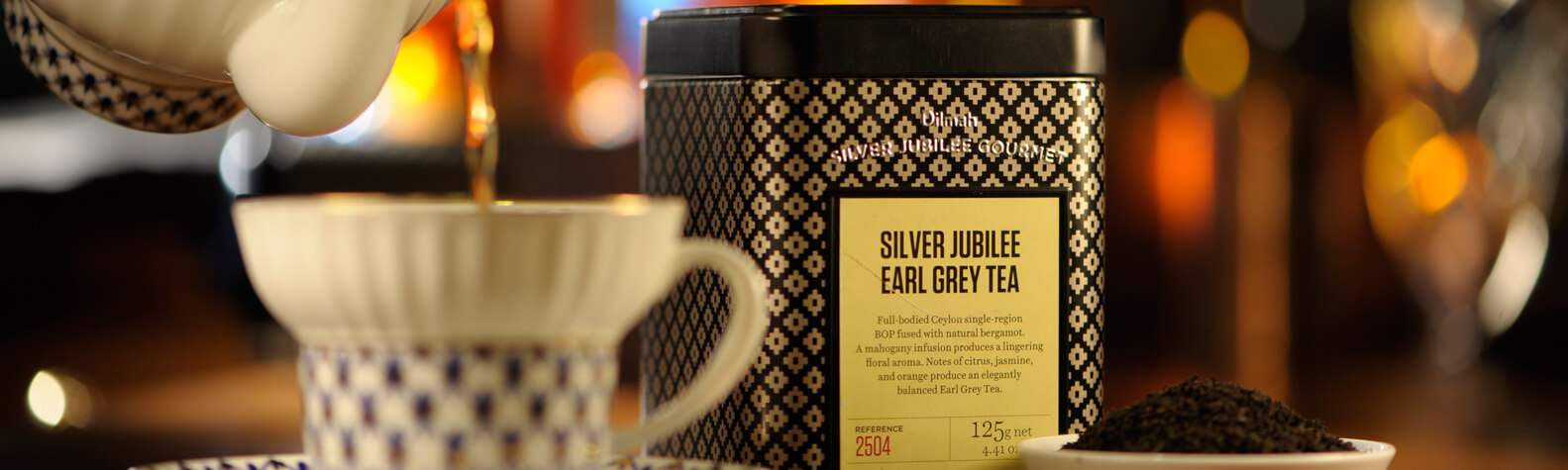 Container of Dilmah Earl Grey Tea and a Cup of Tea