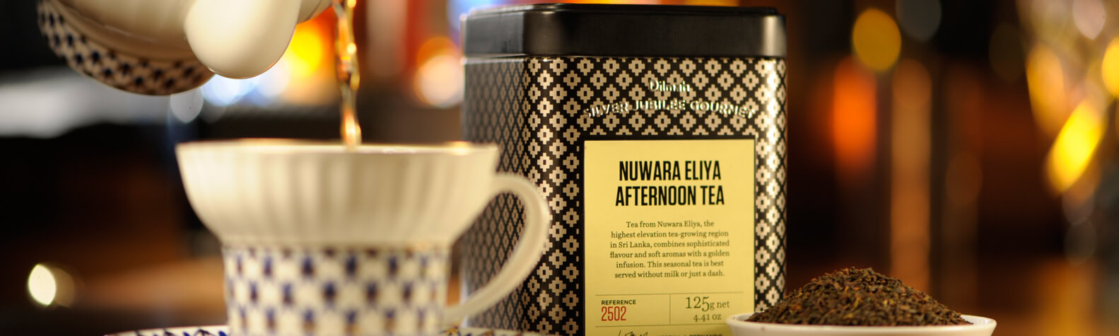 Container of Nuwara Eliya Afternoon Tea and a Cup with a Tea Cup