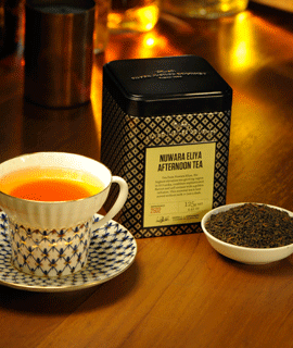 Container of Nuwara Eliya Afternoon Tea and a Cup of Tea