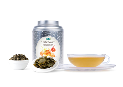 Dried Tea Leaves with a Cup of Tea and a Tin Caddy of Dilmah Vivid Tea