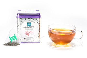 Tea with Pomegranate and Mint Container with a Tea Bag and a Tea Cup