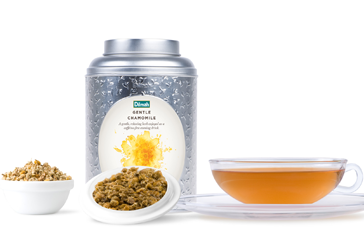 Can of Gentle Camomile Tea with Tea Leaves and a Cup of Tea