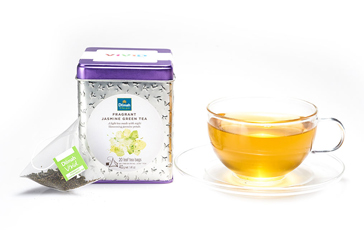 Container of Dilmah Fragrant Jasmine Green Tea with a Tea Bag and a Cup of Tea