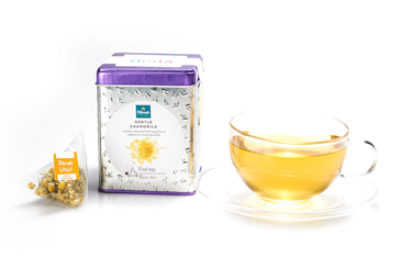 Container of Dilmah Gentle Chamomile Tea with a Tea Bag and a Cup of Tea