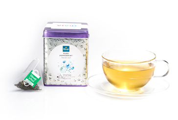 Pack of Dilmah Pure Peppermint Tea with Tea Bags and a Cup of Tea